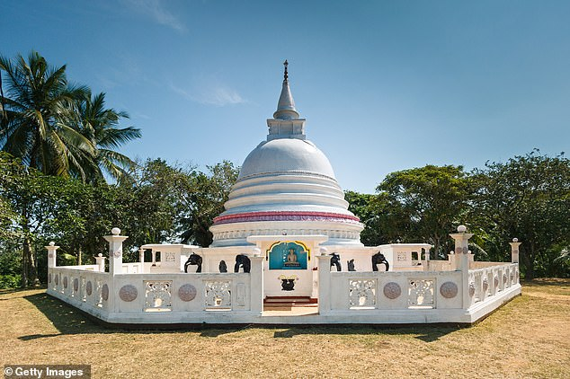 A temple in Mirissa in Sri Lanka.The Sri Lankan rupee has been hit by the rising cost of servicing a national debt that tops £40 billion