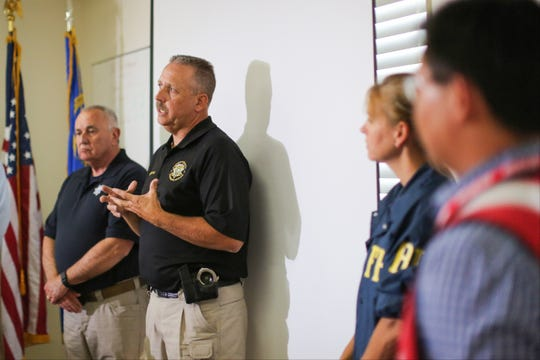 "Lincoln County Sheriff Kerry Lee, center, and Director of the Nevada Department of Public Safety James Wright, left, hold a briefing about a Wednesday night bombing that killed one person in Panaca, Nev., on Thursday, July 14, 2016. Lee told the USA Today Network on Thursday, September 12, 2019 that he was unsure of what to expect at the ""Alienstock"" festival planned for Rachel later this month, but that his team will be ready."