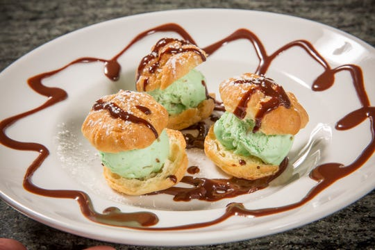 Petite Violette, Atlanta: Their  profiteroles (puff pastry filled with pistachio ice cream) are topped with chocolate sauce infused with blood orange EVOO.